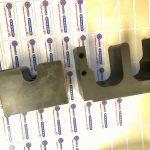 Pièce acier Z160 CDV 12 D 48/48/111 fraisé sur centre d'usinage trempé suivant plan HRC-002